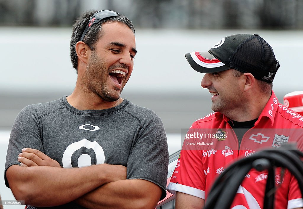 Juan Montoya, driver of the #42 Target Chevrolet, jokes with a crew member during qualifying for the NASCAR Sprint Cup Series Pocono 400 presented by #NASCAR at Pocono Raceway on June 9, 2012 in Long Pond, Pennsylvania.