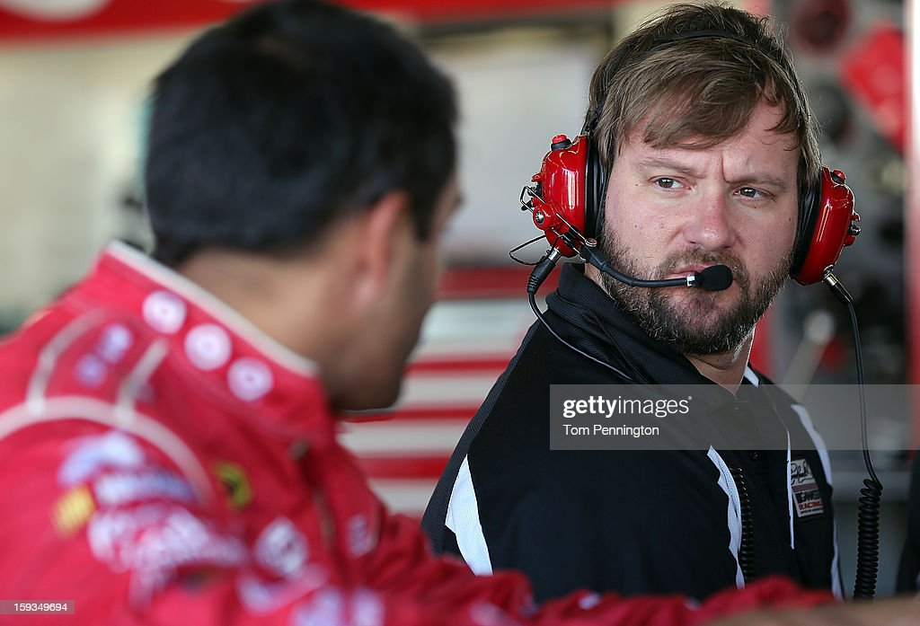 Juan Montoya, driver of the #42 Target Chevrolet, works with crew chief Chris Heroy during the NASCAR Sprint Cup Preseason Thunder testing at Daytona International Speedway on January 12, 2013 in Daytona Beach, Florida.