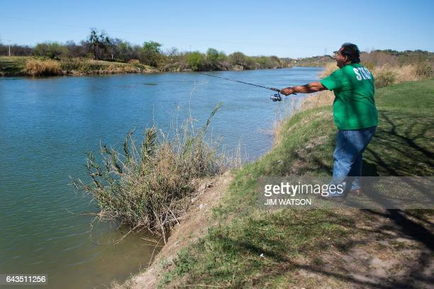 Juan Moreno fishes on the banks of the Rio Grande river on the US/Mexico border in Eagle Pass Texas on February 21 2017 this image is part of an...