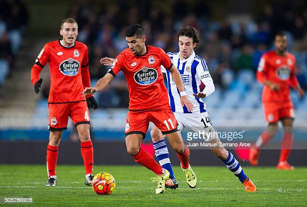 Juan Moreno 'Juanfran'of Deportivo La Coruna duels for the ball with Ruben Pardo of Real Sociedad during the La Liga match between Real Sociedad de...