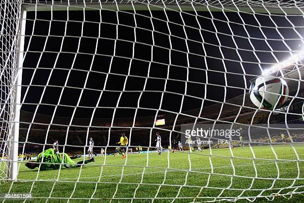 Juan Nazareno of Ecuador scores his team's fourth goal against goalkeeper Aleksandr Maksimenko of Russia during the FIFA U17 World Cup Chile 2015...