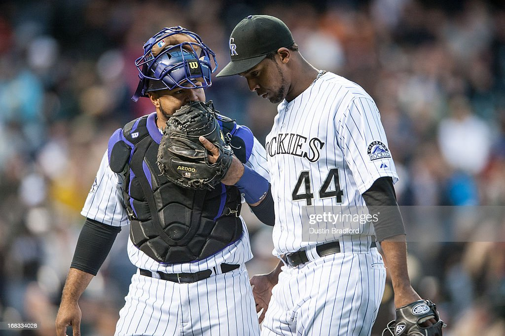 Juan Nicasio #44 and Wilin Rosario #20 of the Colorado Rockies walk off the field after a scoreless frame during a game against the New York Yankees during a game at Coors Field on May 8, 2013 in Denver, Colorado.
