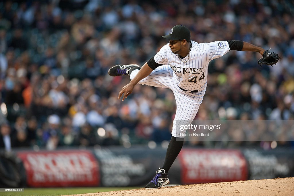 Juan Nicasio #44 of the Colorado Rockies follows through on a pitch against the New York Yankees during a game at Coors Field on May 8, 2013 in Denver, Colorado.