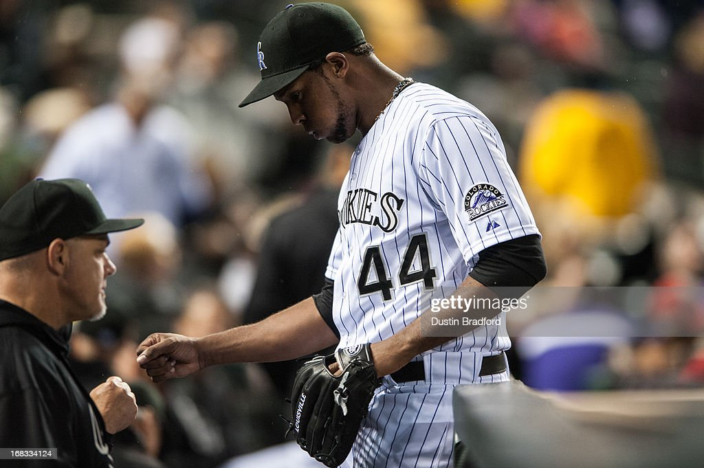 Juan Nicasio #44 of the Colorado Rockies is congratulated after the top of the fifth inning of a game against the New York Yankees at Coors Field on May 8, 2013 in Denver, Colorado.