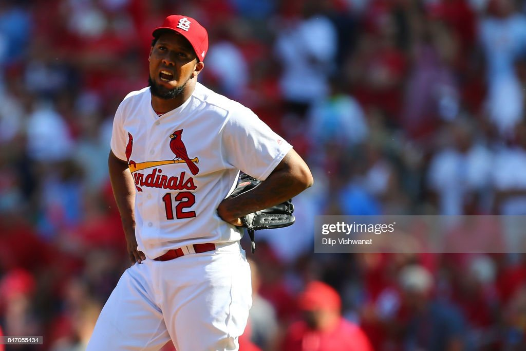 Juan Nicasio #12 of the St. Louis Cardinals reacts after allowing a run to score against the Cincinnati Reds in the ninth inning at Busch Stadium on September 14, 2017 in St. Louis, Missouri.