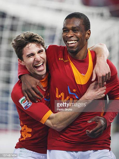 Juan of AS Roma celebrates with teammate Fabio Borini after scoring their team's fourth goal during the Serie A match between AS Roma and AC Cesena...
