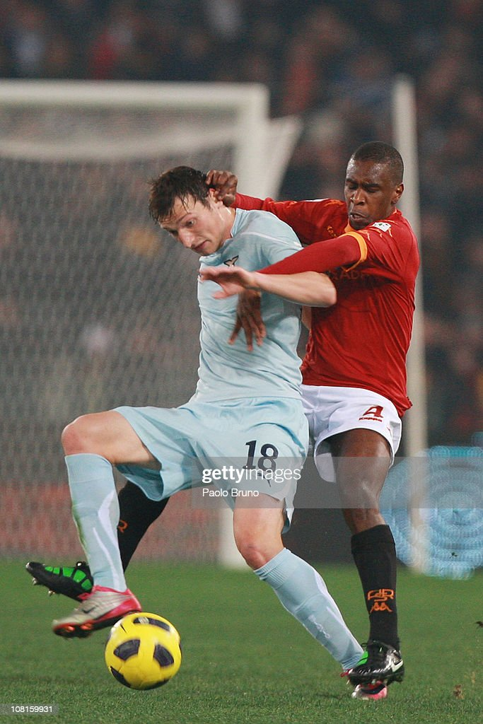 Juan of AS Roma competes for the ball with Libor Kozak of SS Lazio (L) during the Tim Cup match between AS Roma and SS Lazio at Stadio Olimpico on January 19, 2011 in Rome, Italy.