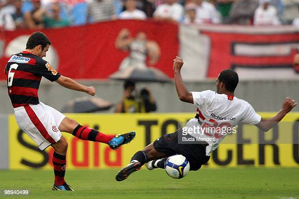 Juan of Flamengo fights for the ball with Richarlison of Sao Paulo during a match as part of the Brazilian Championship at Maracana Stadium on May 9...