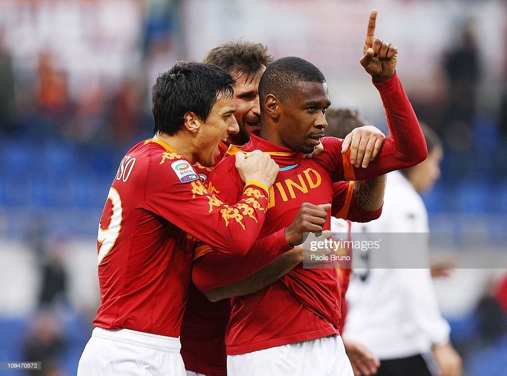 Juan (R) of Roma is congratulated by <a gi-track='captionPersonalityLinkClicked' href=/galleries/search?phrase=Nicolas+Burdisso&family=editorial&specificpeople=490963 ng-click='$event.stopPropagation()'>Nicolas Burdisso</a> (L) and <a gi-track='captionPersonalityLinkClicked' href=/galleries/search?phrase=Mirko+Vucinic&family=editorial&specificpeople=860475 ng-click='$event.stopPropagation()'>Mirko Vucinic</a> of AS Roma after scoring the second goal during the Serie A match between AS Roma and Parma FC at Stadio Olimpico on February 27, 2011 in Rome, Italy.