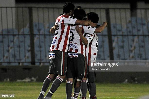 Juan Ortiz of Uruguay's River Plate celebrates scored goal with teammates during their semifinal round match of the 2009 Copa Sudamericana at the...