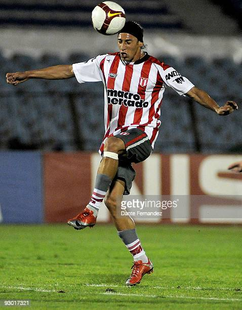 Juan Ortiz of Uruguay's River Plate jumps for the ball during their semifinal round match of the 2009 Copa Sudamericana at the Centenario Stadium on...