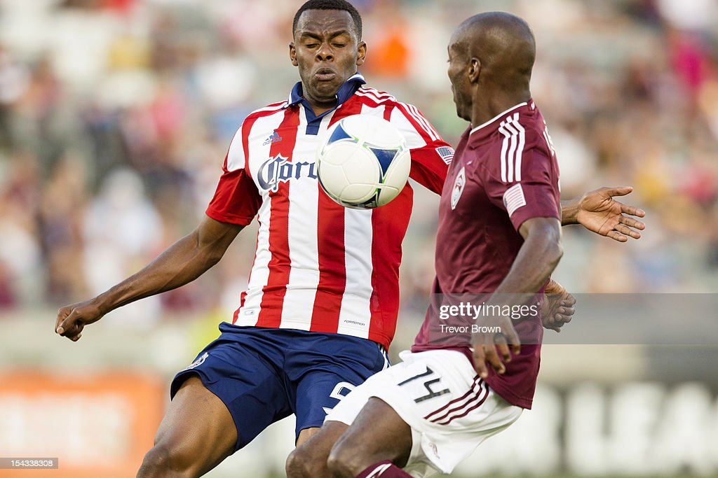 Juan Pablo Angel of Chivas USA and Omar Cummings of the Colorado Rapids battle for possession of the ball during their MLS match at Dick's Sporting...
