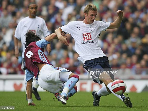 Juan Pablo Angel of Villa slides in on Calum Davenport of Spurs during the Barclays Premiership match between Aston villa and Tottenham Hotspur at...
