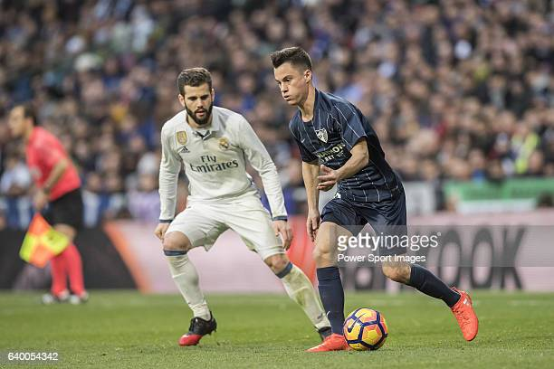 Juan Pablo Anor Acosta Juanpi of Malaga CF fights for the ball with José Ignacio Fernández Iglesias Nacho of Real Madrid during their La Liga 201617...