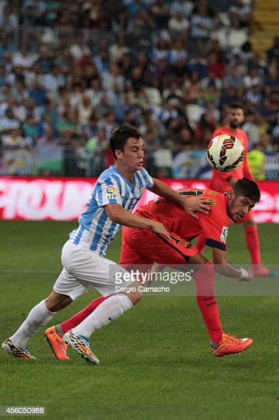 Juan Pablo Anor alias Juanpi of Malaga CF duels for the ball with Neymar da Silva of FC Barcelona during the La Liga match between Malaga CF and FC...