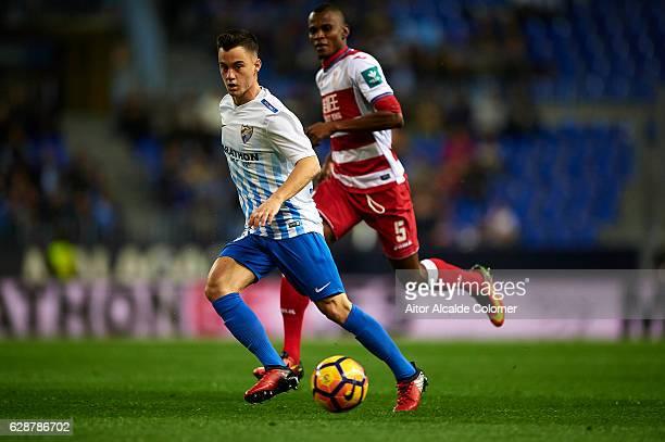 Juan Pablo Anor 'Juanpi' of Malaga CF being followed by Uche Henry Agbo of Granada CF during La Liga match between Malaga CF and Granada CF at La...