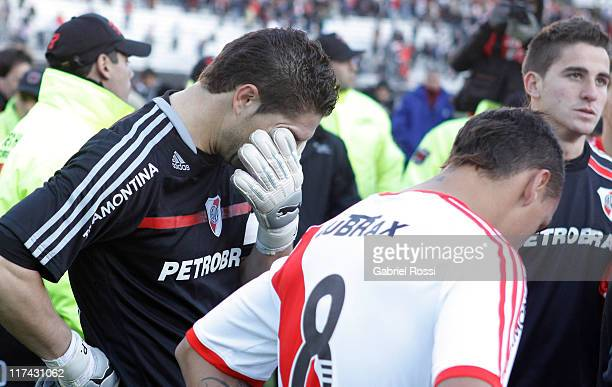 Juan Pablo Carrizo cries after the match between River Plate and Belgrano de Cordoba as part of the promotion to keep the category on the Clausura...
