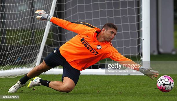 Juan Pablo Carrizo of FC Internazionale Milano dives to save a shot during FC Internazionale training session at the club's training ground on...