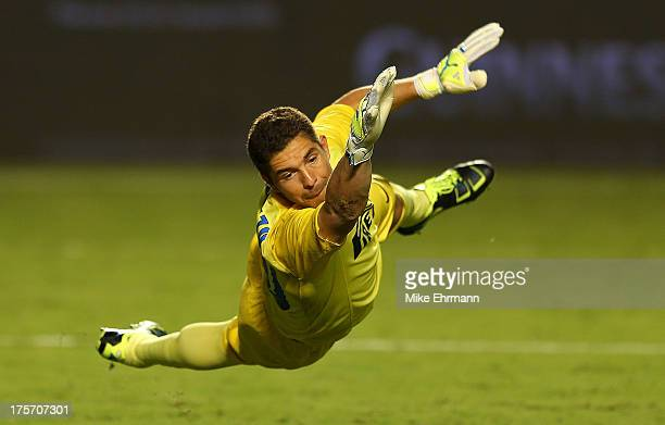 Juan Pablo Carrizo of Inter Milan misses a save during an International Champions Cup Seventh Place Match against the Juventus at Sun Life Stadium on...