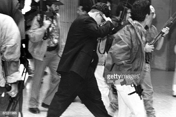 Juan Pablo Escobar son of drug kingpin Pablo Escobar is escorted by bodyguards from the Colombian Attorney General 's office in Medellin Colombia 27...