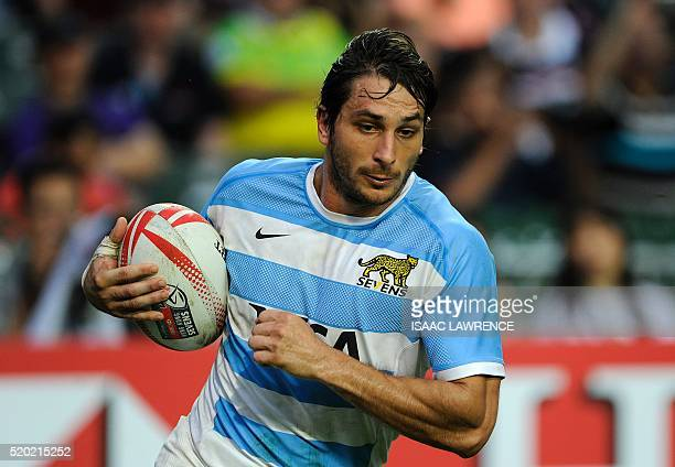 Juan Pablo Estelles of Argentina runs for a try against Scotland during the Bowl Final of the Hong Kong Sevens rugby tournament in Hong Kong on April...