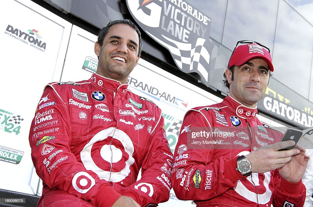 <a gi-track='captionPersonalityLinkClicked' href=/galleries/search?phrase=Juan+Pablo+Montoya&family=editorial&specificpeople=202004 ng-click='$event.stopPropagation()'>Juan Pablo Montoya</a>, co-driver of the #01 TELMEX/Target BMW Riley and <a gi-track='captionPersonalityLinkClicked' href=/galleries/search?phrase=Dario+Franchitti&family=editorial&specificpeople=171306 ng-click='$event.stopPropagation()'>Dario Franchitti</a> co-driver of the #02 Target/TELMEX BMW Riley at Daytona International Speedway on January 25, 2013 in Daytona Beach, Florida.