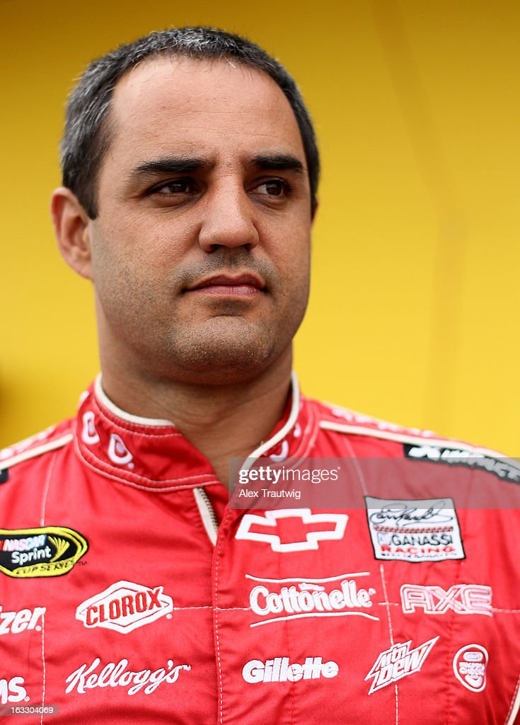 Juan Pablo Montoya, driver of the AXE Apollo Chevrolet, stands in the garage area during NASCAR Sprint Cup Series testing at Las Vegas Motor Speedway on March 7, 2013 in Las Vegas, Nevada.