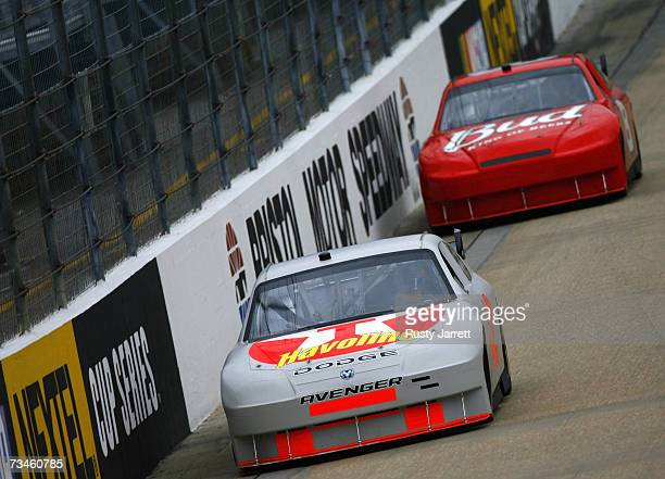 Juan Pablo Montoya driver of the Ganassi Racing Texaco/Havoline Dodge leads Dale Earnhardt Jr driver of the Budweiser Chevrolet during NASCAR Car of...