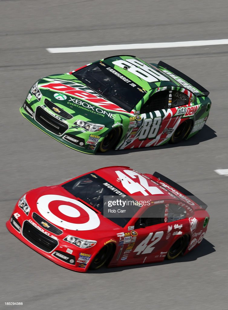 Juan Pablo Montoya, driver of the #42 Target Chevrolet, and Dale Earnhardt Jr., driver of the #88 Mountain Dew / XBox One Chevrolet, during practice for the NASCAR Sprint Cup Series 45th Annual Camping World RV Sales 500 at Talladega Superspeedway on October 18, 2013 in Talladega, Alabama.