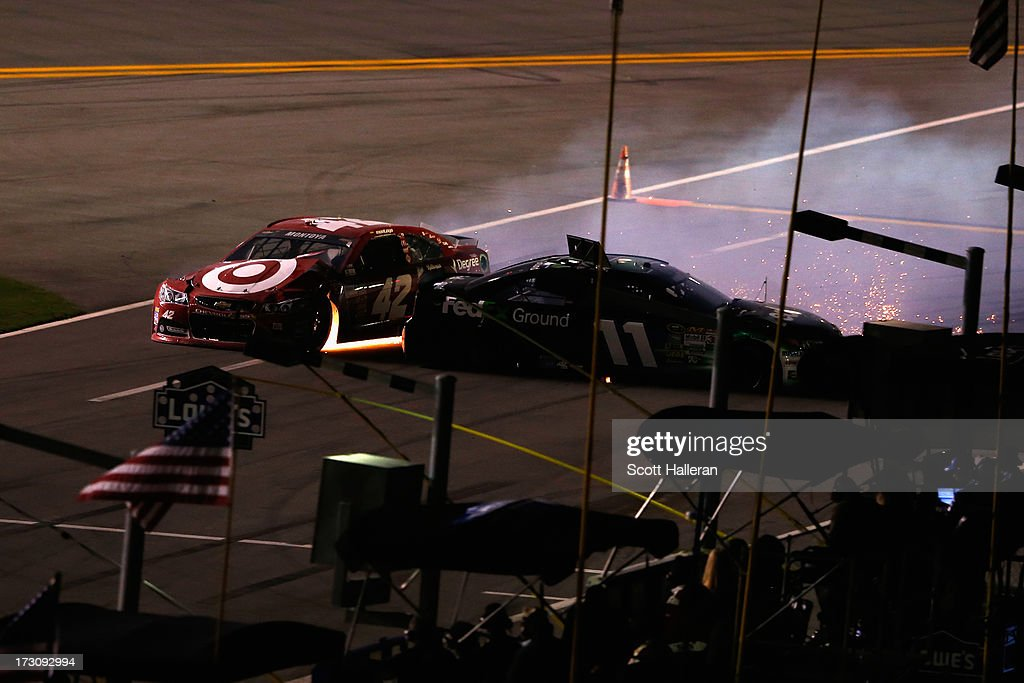 Juan Pablo Montoya, driver of the #42 Target Chevrolet, and Denny Hamlin, driver of the #11 FedEx Ground Toyota, are involved in an incident during the NASCAR Sprint Cup Series Coke Zero 400 at Daytona International Speedway on July 6, 2013 in Daytona Beach, Florida.