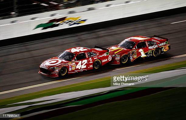 Juan Pablo Montoya driver of the Target Chevrolet and Jamie McMurray driver of the McDonald's Chevrolet bump draft as they race during the NASCAR...