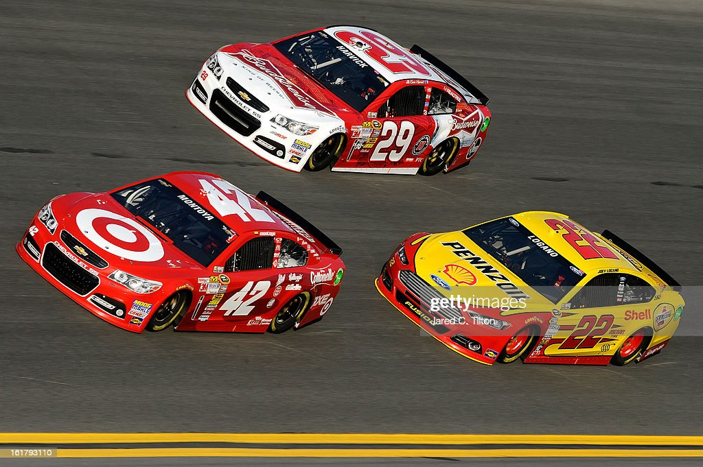 Juan Pablo Montoya, driver of the #42 Target Chevrolet, Kevin Harvick, driver of the #29 Budweiser Chevrolet, and Joey Logano, driver of the #22 Shell-Pennzoil/AAA Ford, during practice for the NASCAR Sprint Cup Series Daytona 500 at Daytona International Speedway on February 16, 2013 in Daytona Beach, Florida