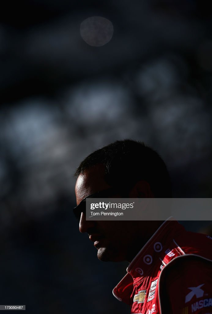 <a gi-track='captionPersonalityLinkClicked' href=/galleries/search?phrase=Juan+Pablo+Montoya&family=editorial&specificpeople=202004 ng-click='$event.stopPropagation()'>Juan Pablo Montoya</a>, driver of the #42 Target Chevrolet, looks on during qualifying for the NASCAR Sprint Cup Series Coke Zero 400 at Daytona International Speedway on July 5, 2013 in Daytona Beach, Florida.