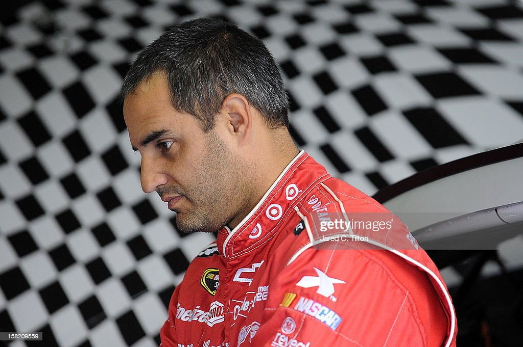 Juan Pablo Montoya, driver of the #42 Target Chevrolet, looks on in the garage area during testing at Charlotte Motor Speedway on December 11, 2012 in Concord, North Carolina.