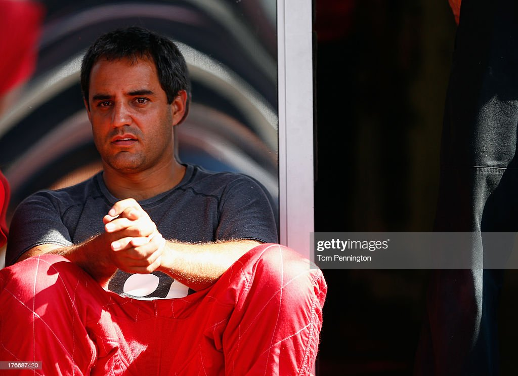 <a gi-track='captionPersonalityLinkClicked' href=/galleries/search?phrase=Juan+Pablo+Montoya&family=editorial&specificpeople=202004 ng-click='$event.stopPropagation()'>Juan Pablo Montoya</a>, driver of the #42 Target Chevrolet, sits in the garage area during practice for the NASCAR Sprint Cup Series 44th Annual Pure Michigan 400 at Michigan International Speedway on August 17, 2013 in Brooklyn, Michigan.