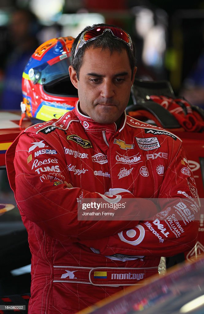 Juan Pablo Montoya, driver of the #42 Target Chevrolet, stands in the garage area during practice for the NASCAR Sprint Cup Series Auto Club 400 at Auto Club Speedway on March 23, 2013 in Fontana, California.