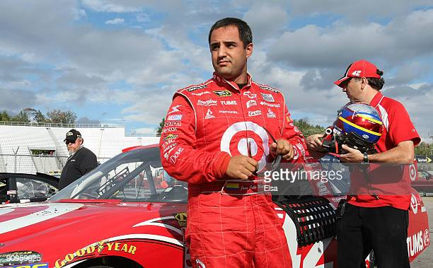 Juan Pablo Montoya driver of the Target Chevrolet stands near his car after his run during qualifying for the NASCAR Sprint Cup Series Sylvania 300...