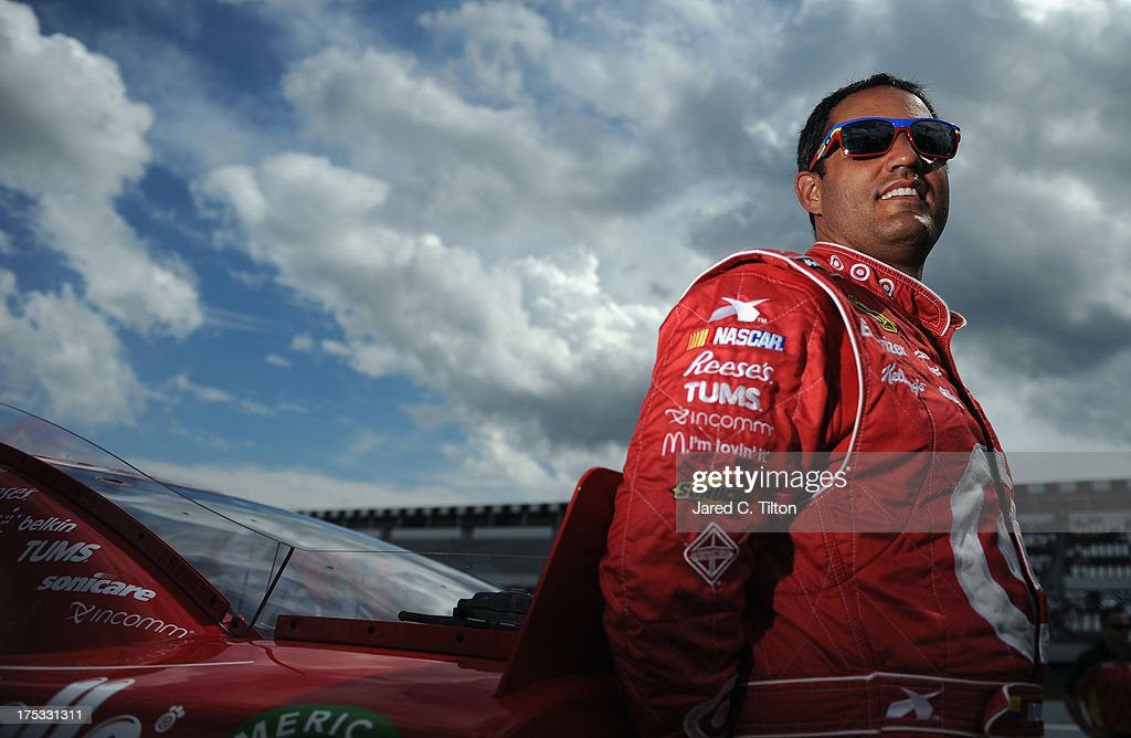 <a gi-track='captionPersonalityLinkClicked' href=/galleries/search?phrase=Juan+Pablo+Montoya&family=editorial&specificpeople=202004 ng-click='$event.stopPropagation()'>Juan Pablo Montoya</a>, driver of the #42 Target Chevrolet, stands on the grid during qualifying for the NASCAR Sprint Cup Series GoBowling.com 400 at Pocono Raceway on August 2, 2013 in Long Pond, Pennsylvania.