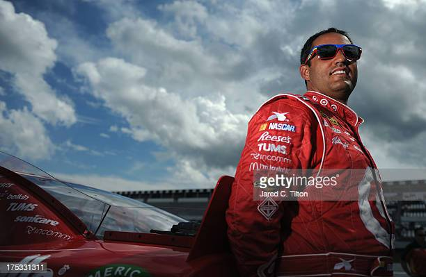 Juan Pablo Montoya driver of the Target Chevrolet stands on the grid during qualifying for the NASCAR Sprint Cup Series GoBowlingcom 400 at Pocono...