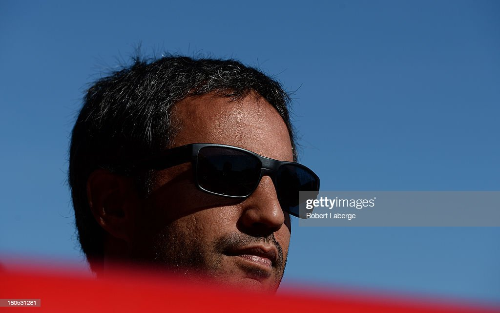 Juan Pablo Montoya, driver of the #42 Target / Kraft Chevrolet, looks on during practice for the NASCAR Sprint Cup Series Geico 400 at Chicagoland Speedway on September 14, 2013 in Joliet, Illinois.
