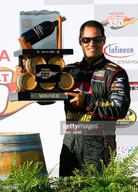 Juan Pablo Montoya driver of the Texaco/Havoline Dodge celebrates in the winner's circle after winning the NASCAR Nextel Cup Series Toyota/Save Mart...