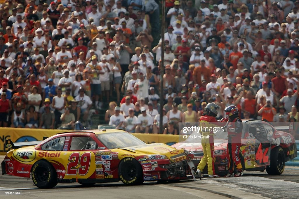 Juan Pablo Montoya driver of the Wrigley's Big Red Dodge and Kevin Harvick driver of the Shell/Pennzoil Chevrolet exchange words after crashing into...