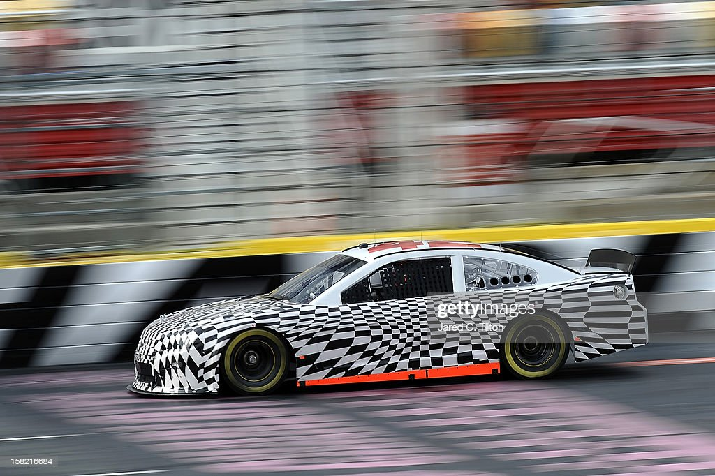 Juan Pablo Montoya drives the Earnhardt Ganassi Racing Chevrolet during testing at Charlotte Motor Speedway on December 11, 2012 in Concord, North Carolina.