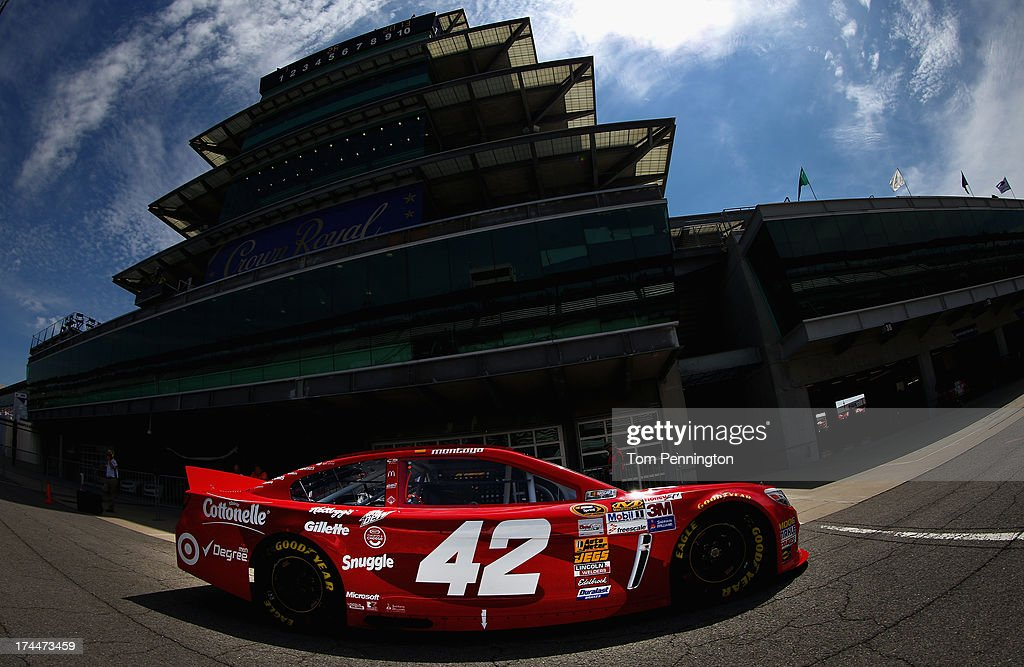 Juan Pablo Montoya drives the #42 Target Chevrolet through the garage area during practice for the NASCAR Sprint Cup Series Samuel Deeds 400 At The Brickyard at Indianapolis Motor Speedway on July 26, 2013 in Indianapolis, Indiana.