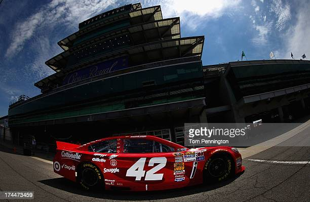 Juan Pablo Montoya drives the Target Chevrolet through the garage area during practice for the NASCAR Sprint Cup Series Samuel Deeds 400 At The...