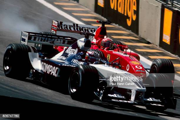 Juan Pablo Montoya Michael Schumacher WilliamsBMW FW24 Ferrari F2002 Grand Prix of Brazil Interlagos 26 March 2000