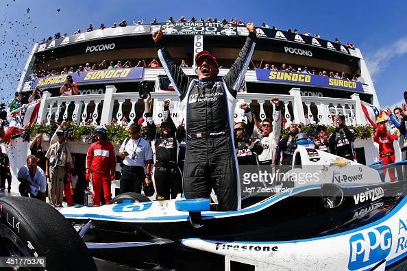Juan Pablo Montoya of Colombia driver of the PPG Team Penske Chevrolet celebrates his victory in the Pocono INDYCAR 500 at Pocono Raceway on July 6...