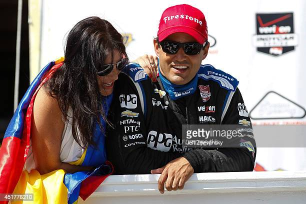 Juan Pablo Montoya of Colombia driver of the PPG Team Penske Chevrolet celebrates with wife Connie after winning the Pocono INDYCAR 500 at Pocono...