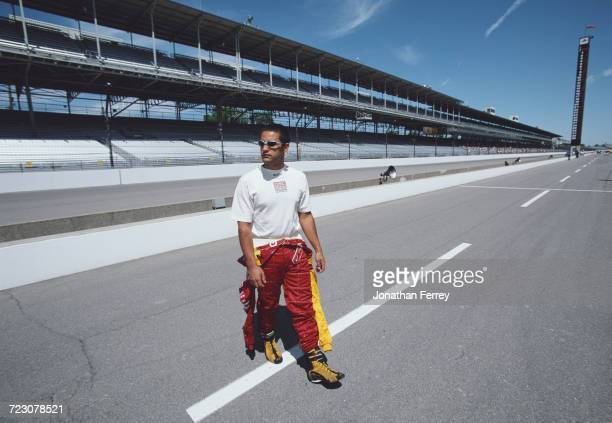 Juan Pablo Montoya of Colombia driver of the Target Chip Ganassi Racing GForce GF05a Oldsmobile walks down pit lane during practice for the 2000 Indy...