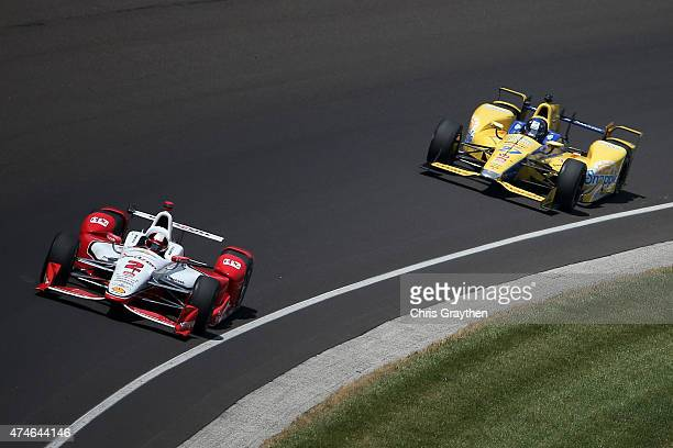 Juan Pablo Montoya of Colombia driver of the Team Penske Chevrolet Dallara drives during the 99th running of the Indianapolis 500 mile race at...